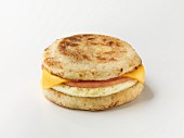 An English muffin with sausage and cheese