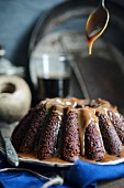 A wreath cake with black beer and caramel sauce