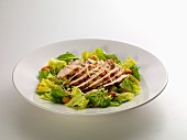 Caesar salad with chicken breast