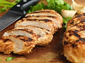 Grilled chicken breasts, sliced