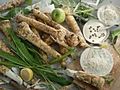 Horseradish roots, leaves, dip, and grated horseradish