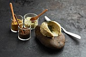 Homemade spice butter with different types of salt in glasses