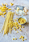 Various types of pasta and grated cheese