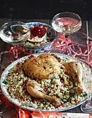Stuffed chicken with couscous and pomegranate seeds