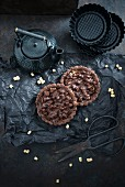 Vegan chocolate tartlets with oat pops
