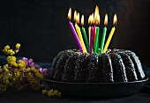 A vegan gugelhupf with birthday candles