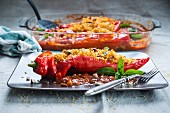 Peppers stuffed with bulgur wheat and nuts in tomato sauce (vegan)