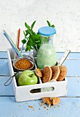 Kefir melon smoothie with mint, and pollen biscuits with sesame and apple