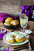 Baked potatoes with sour cream and herring sauce