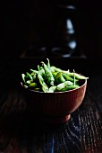 Steamed edamame beans with salt flakes japanese restaurant style