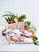 Gemüsekiste, Lammfleisch, Wurst, Räucherlachs, Hühnerkeulen und Tacos