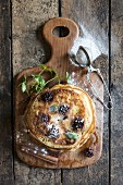 Traditional American pancakes with berries and maple syrup