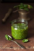 Basil pesto in a glass jar