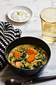 Spinach curry with carrots and red lentils