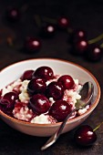 Rice pudding with cherries in port wine sauce