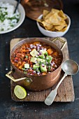 Vegan chili with sweet potatoes and avocado