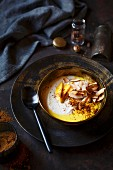 A coconut smoothie bowl with turmeric and mango