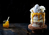A layer cake glazed with cream cheese and lemon curd for Easter