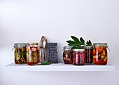 Various pickling jars with vegetables and fruit