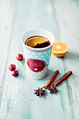 Cherry mulled wine in a porcelain mug