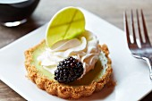 Mini keylime pie with a blackberry