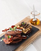 Double Chocolate Flapjacks with Grilled bananas and crispy streaky bacon