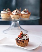 Pastels de Nata with chocolate, whipped cream and figs