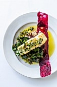 Kingklip with brown butter and capers, black olive tapenade, potatoes and Swiss chard decorated with beetroot puree