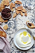 Lemon labneh with harissa olive and sumac pita chips