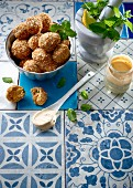 Deep fried sesame balls with a yogurt and tahini dip