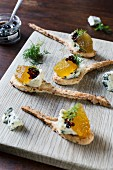 Crispbread spoons with gorgonzola, watermelon jelly, and balsamic caviar