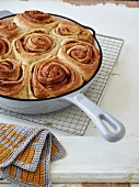 Danish cinnamon rolls in an enamel pan