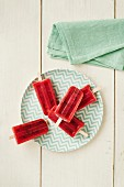 Strawberry sorbet lollies on sticks