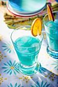 Blue cocktails with orange slices