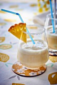Pina colada cocktails with slices of pineapple