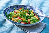 Potato salad with green beans, peaches and arugula
