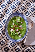 Courgette cream soup with mint and arugula