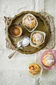Almond muffins served with coffee (top view)