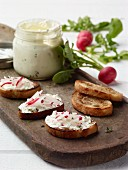 Radishes and sour cream spread on toasted bread