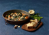 Spinach gratin with sweet potato dumplings