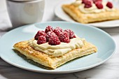 Puff pastry slices with vanilla cream and raspberries