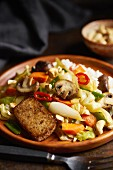 Stir fried vegetables with mushrooms, chili, cashews and marinated fried tofu (Asia)