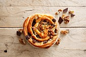 A puff pastry snail with chocolate and walnuts