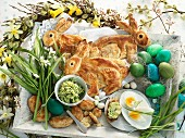 Puff pastry Easter bunnies, dyed eggs, chocolate eggs, herb butter, and toast