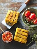 Grilled polenta slices with tomato salsa