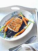 A zander fillet with beluga lentils and carrots