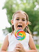 Girl licking colorful lollipop