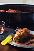 Stuffed cabbage parcels with pureed tomato sauce