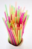 Colourful neon straws in a pitcher