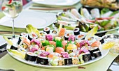 Various types of sushi on a round serving platter (Japan)